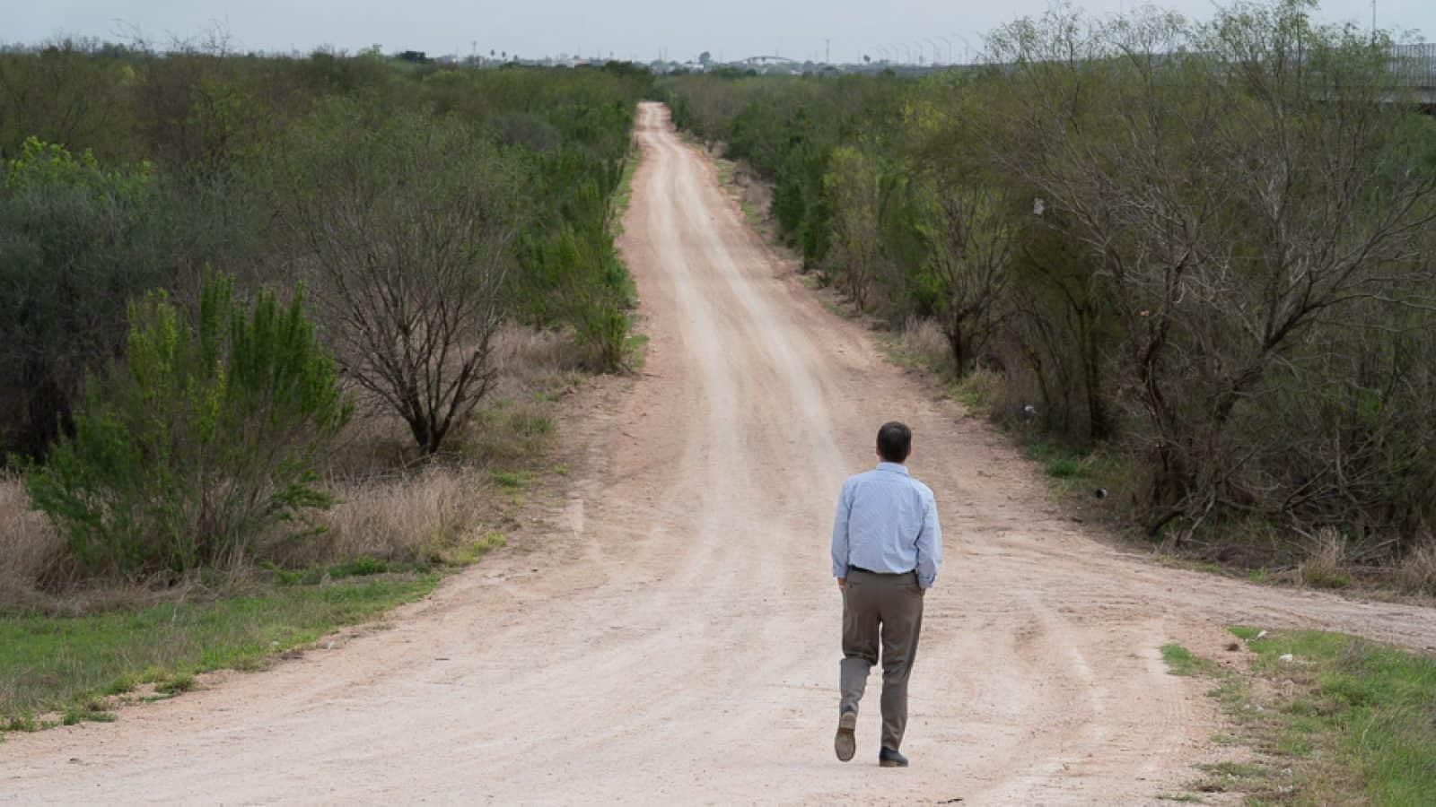 Jay Timmons walks along U.S. - Mexico Border