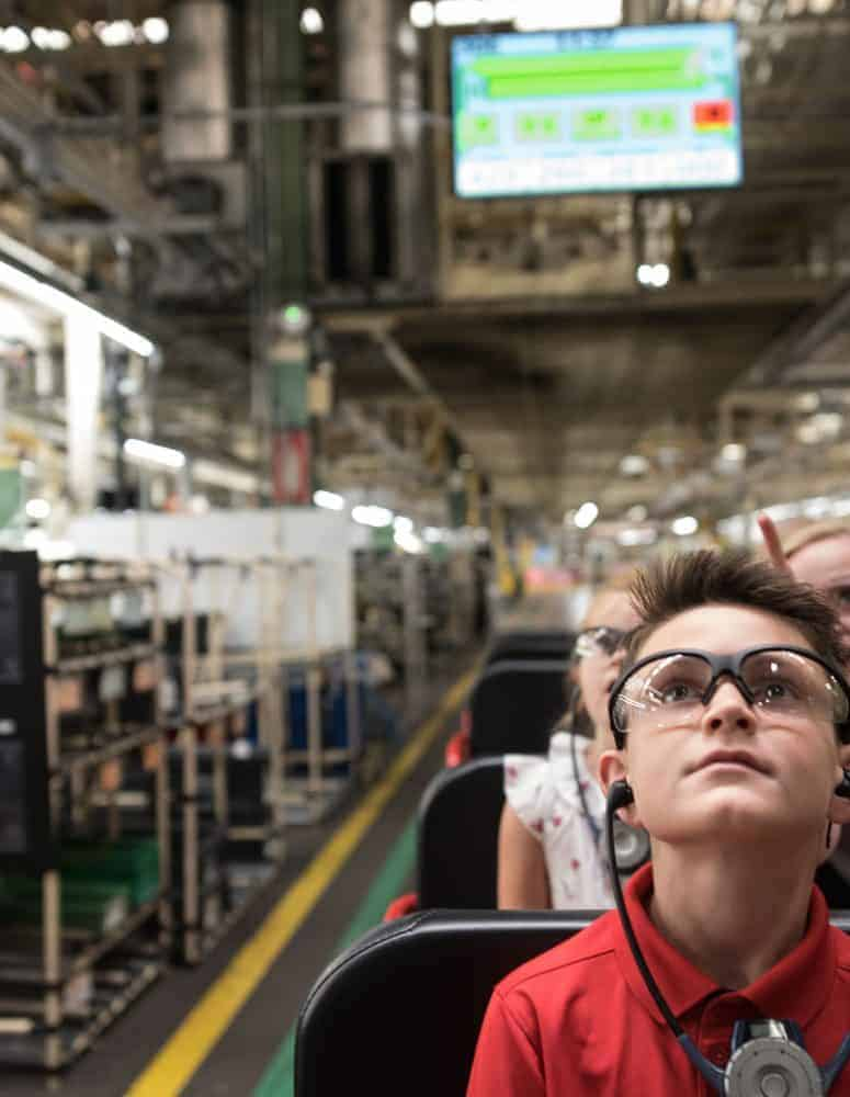 Child on tour of shop floor (Toyota)