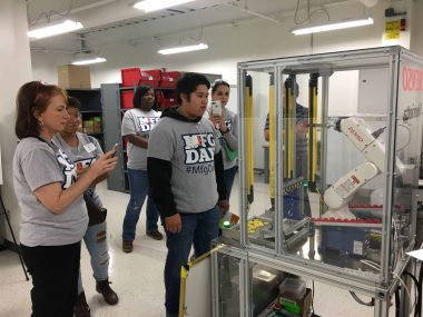 Students examining equipment at DENSO