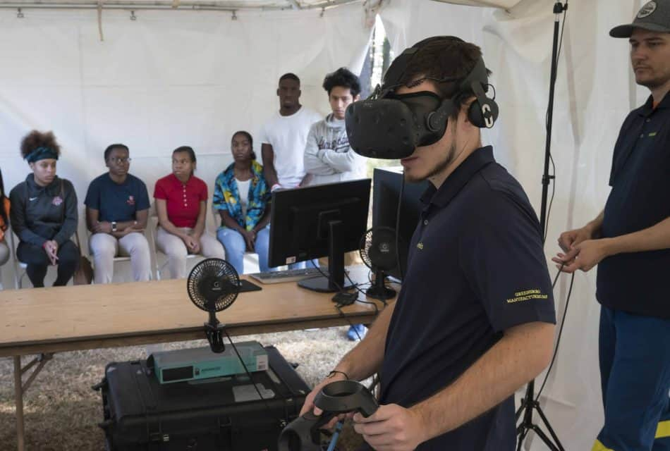 Student wears VR glasses at Novelis' Manufacturing Day event