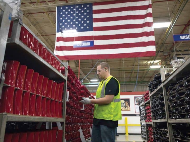 Manufacturing Worker With Flag in Background